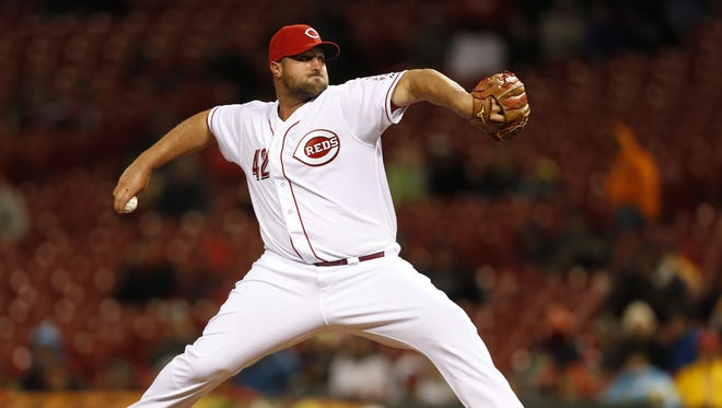 Cincinnati Reds relief pitcher Jonathan Broxton (51) works the mound in the ninth inning.