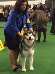 Sabrina Czarapata holds Casio as the 3-year-old dog