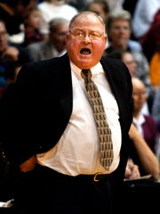Ken Shields yells out to his team on his way to his