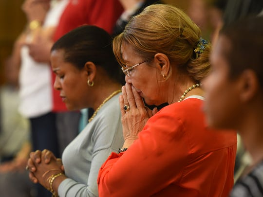 The congregation prays during an Easter Mass at St.