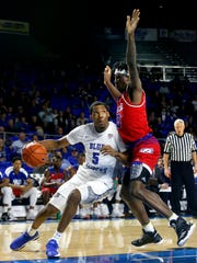 MTSU's Nick King (5) goes to the basket as Louisiana Tech's Anthony Duruji (10) defends during a game Jan. 11.