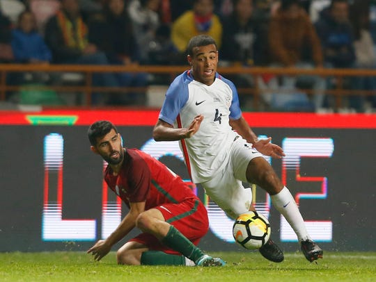 Tyler Adams, right, controls the ball in front of Portugal's Luis Neto during an international friendly match at the Dr. Magalhaes Pessoa stadium in Leiria, Portugal last month.