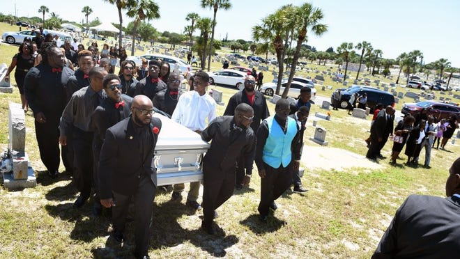 Pallbearers carry the coffin of Demarcus Semer, 21, of Fort Pierce, April 30, 2016 during the graveside service at Riverview Memorial Park in Fort Pierce. Semer was fatally shot by Fort Pierce police on April 23, 2016. (JEREMIAH WILSON/TREASURE COAST NEWSPAPERS)