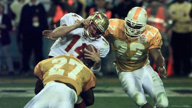 Tennessee's Al Wilson (27) sacks Florida State quarterback Marcus Outzen in the third quarter of the national championship game on Jan. 4, 1999, in Tempe, Ariz. Coming up to help is Corey Terry. The Vols beat the Seminoles, 23-16.