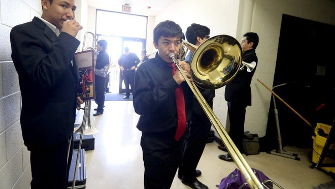 GABE HERNANDEZ/CALLER-TIMES Jesus Diaz plays his trombone as he warms up before performing in the Region XIV All-Region High School Jazz Band and Middle School Band Concert on Saturday Jan. 30, 2016, at Flour Bluff High School Auditorium in Corpus Christi.