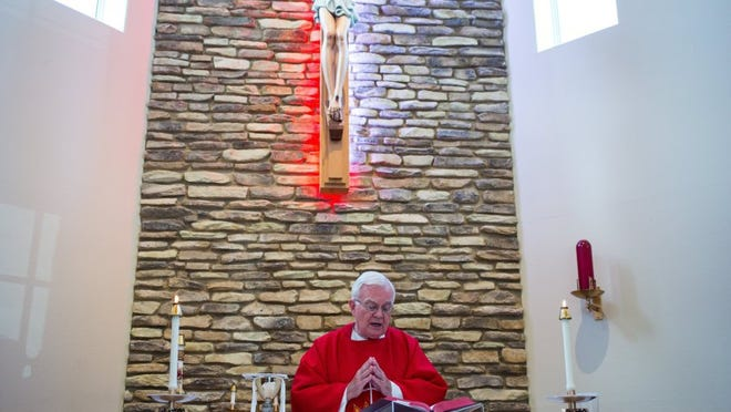 COURTNEY SACCO/CALLER-TIMES Father Matthew Stephan celebrates Mass on Wednesday, July 20, 2016, in the chapel in the community center at St. John Vianney Residence for Priests in Corpus Christi.