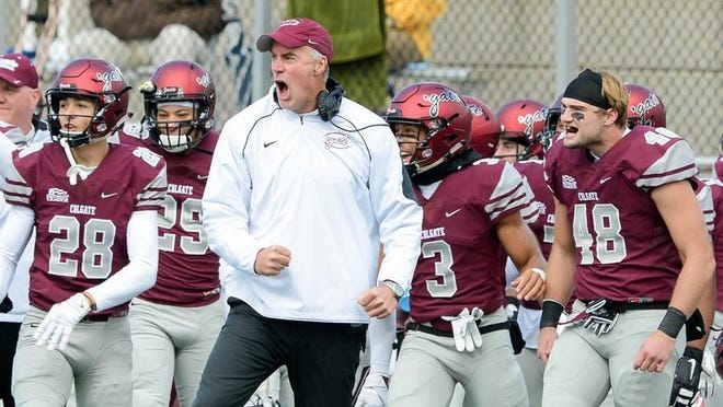 Colgate coach Dan Hunt, center, said he thinks there could be changes to the college football season this year.