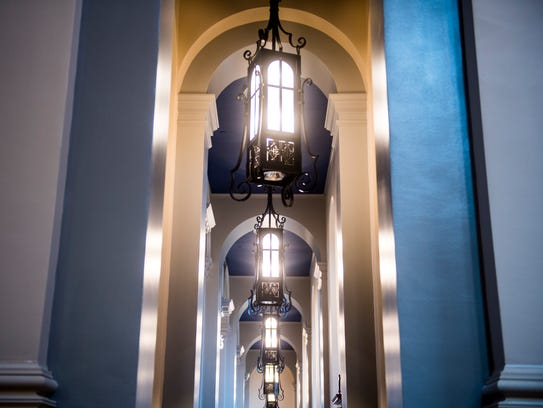 Lights hang along a walkway inside the new Cathedral