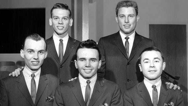 Several young Memphis men were following in the well-known footsteps of their fathers in March 1963. Three of the newly formed group, which calls itself the Blackwood Junior Quartet, are sons of original members of the group who lost their lives in a plane crash nearly nine years ago. The group includes from left (front row) James Blackwood Jr., Ronald Blackwood, Winston Blackwood and (back row) Everett Reece, pianist, and Bill Lyles Jr. Lyles is the son of Bill Lyles, bass member of the original group. Ronald and Winston are sons of the late R.W. Blackwood, who was the famed baritone.