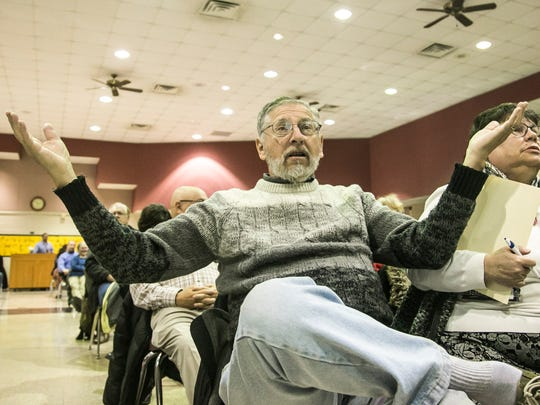 Joseph Butler, of Springettsbury Township, gestures, during Rep. Scott Perry's town-hall meeting Saturday, March 18, 2017, at the Red Lion Area Junior High School. Amanda J. Cain photo