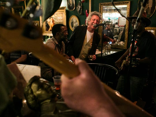 Mark Keller, 68, sings along with Carl and Co., a band performing covers of classic rock hits at Cafe d'Mongo's on Friday, June 23, 2017. (Brittany Greeson, Special to the Free Press)