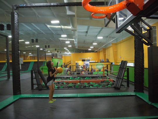 Zoey Rodriguez, 10, jumps and aims up a shot in the
