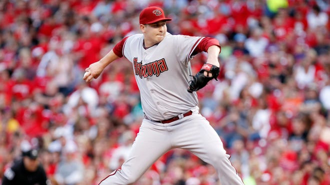 Diamondbacks pitcher Trevor Cahill (35) pitches during the third inning against the Cincinnati Reds at Great American Ball Park.