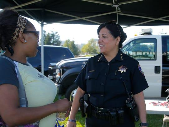 Salinas resident Elitha Clay visits with Salinas Police