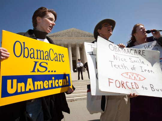 People protest against the health care law March 26, 2012, outside of the Supreme Court in Washington, D.C.