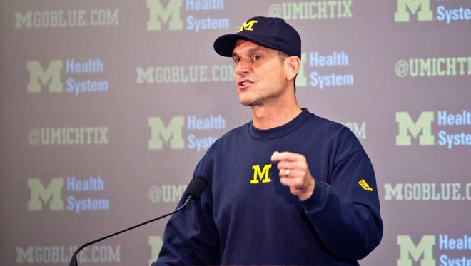 In this Aug. 6, 2015, file photo, Michigan head coach Jim Harbaugh speaks at a press conference during the NCAA college football team's annual media day in Ann Arbor, Mich.