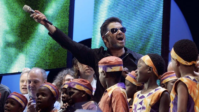A previously unreleased song by George Michael, seen here at the 2008 Live 8 benefit, debuted Thursday.