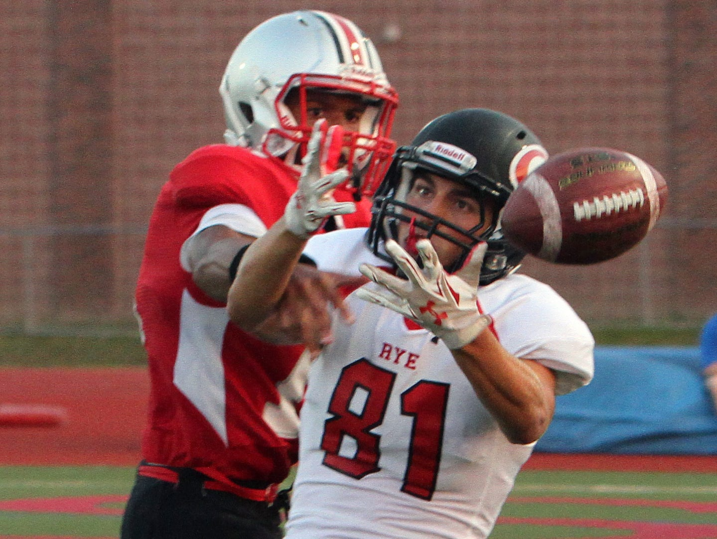 Somers's Jason Holland (11) breaks up a pass intended for Rye's Brett Egan (81) during first half action at Somers High School Sept. 4, 2015