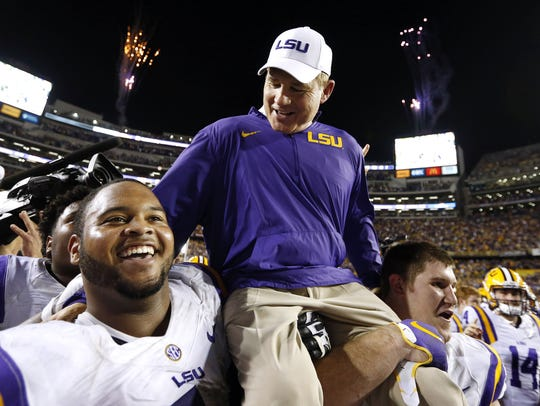 LSU head coach Les Miles is carried off the field after