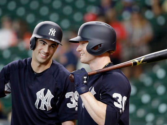 New York Yankees outfielder Clint Frazier (30), right,