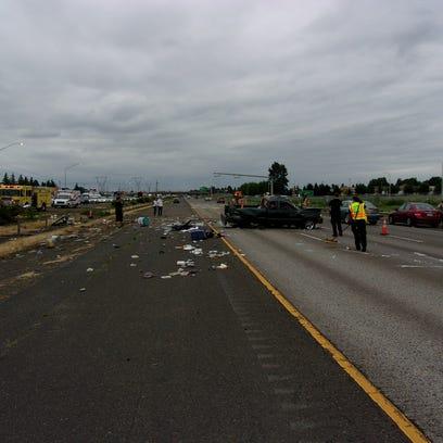 A Ford Ranger blocks a northbound lane on Interstate