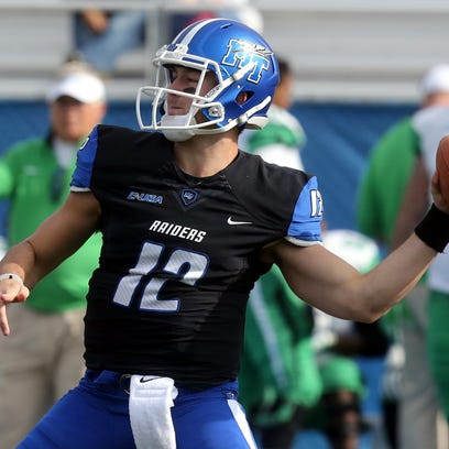 MTSU's quarterback Brent Stockstill (12)  drops back