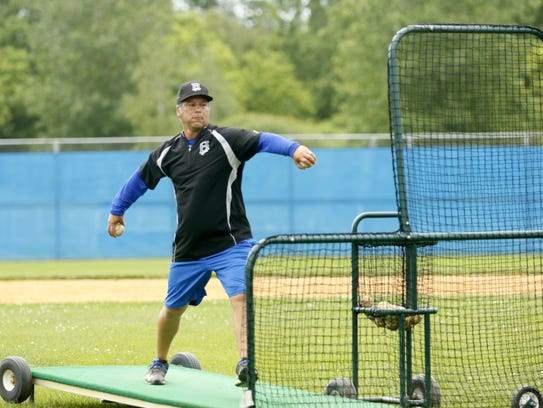 Horseheads coach Jeff Limoncelli pitches batting practice