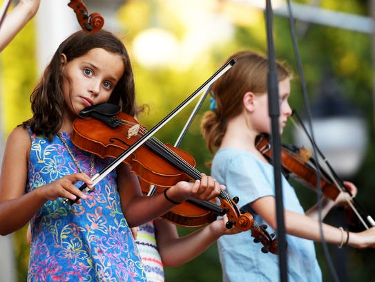 Asheville Music School students perform at Shindig on the Green at Pack Square Park in August 2017. The music school was voted best music program in the Family Choice Awards.