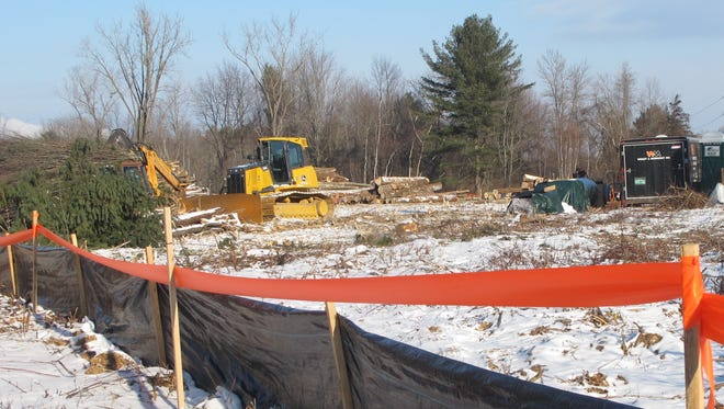 In January: An erosion barrier defines the boundary of a work site in Shelburne where heavy equipment clears and grades a 19-acre parcel along the LaPlatte River. Vermont Railways plans to begin construction here on a transfer station for road salt shipments.