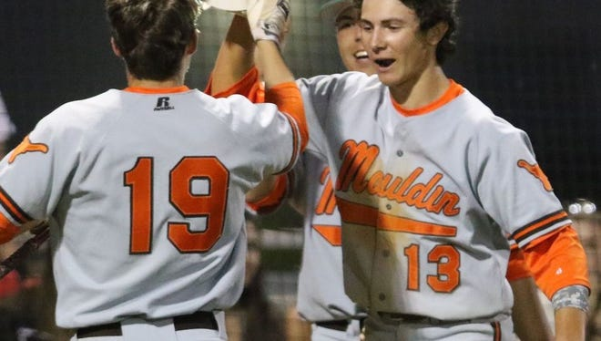 Mauldin's Connor Sult (19) gets a high-five from teammate Bryce Teodosio (19) after scoring in the seventh inning of the Mavericks' 6-2 win at Hillcrest Thursday night.