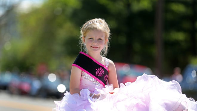 Izabelle Beekman, 5, is Little Miss Dogwood for the annual festival and parade. She said to qualify she had to audition and be able to talk and not be shy. Despite Friday's mass murder of eight people from the same extended family, the annual festival continued through the weekend.