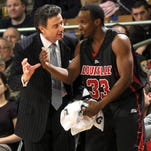 Louisville coach Rick Pitino and former player Andre McGee during a game on Feb. 12, 2009. McGee joined the Louisville basketball staff the following year.