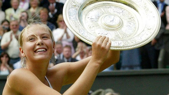 """From July 3, 2004, Russia's Maria Sharapova holds the winner's trophy after defeating Serena Williams in the Women's Singles final match on the Centre Court at Wimbledon. Sharapova is retiring from professional tennis at the age of 32 after five Grand Slam titles and time ranked No. 1. She has been dealing with shoulder problems for years. In an essay written for Vanity Fair and Vogue about her decision to walk away from the sport, posted online Wednesday, Feb. 26, 2020, Sharapova asks: """"How do you leave behind the only life you've ever known?"""""""