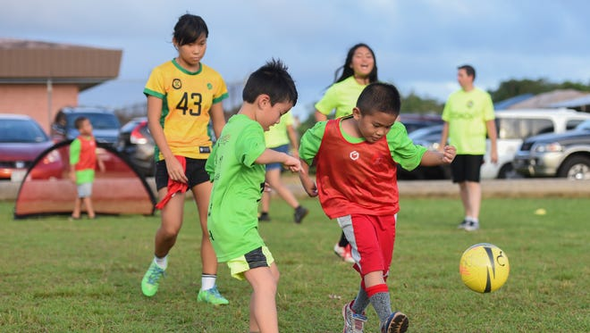 E-Soccer participants play non-competitive games with each other at the Dededo Sports Complex on Oct. 5.