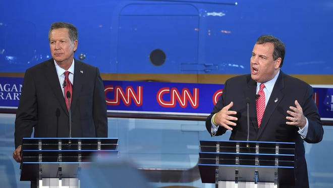Republican presidential candidate, New Jersey Gov. Chris Christie, right, speaks as John Kasich looks on during the CNN Republican presidential debate at the Ronald Reagan Presidential Library and Museum on Wednesday, Sept. 16, 2015, in Simi Valley, Calif.