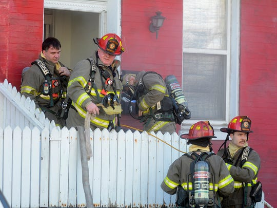 York City firefighters work to clear smoke from a home in the 200 block of S. Pine Street, Wednesday, February 21, 2018. John A. Pavoncello