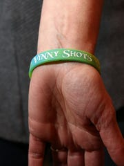"""Suzanne Viafore wears a bracelet that says """"Vinny Shots"""" to remember her ex-husband, Vincent on Feb. 26, 2018."""