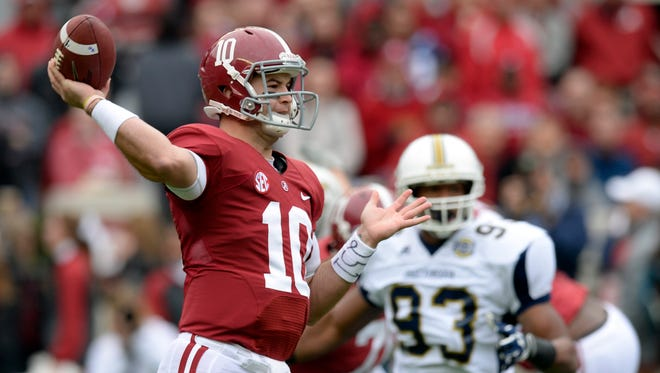 Alabama quarterback A.J. McCarron (10) looks downfield to pass against Chattanooga during the first quarter Saturday at Bryant-Denny Stadium.