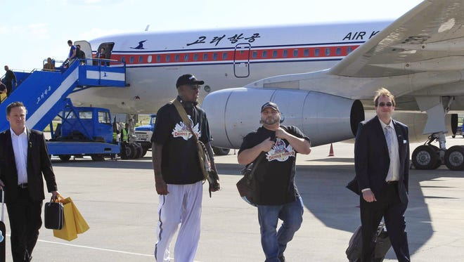 Former NBA star Dennis Rodman, third right,  arrives at Pyongyang airport, North Korea, earlier this month. The airline hopes to expand.