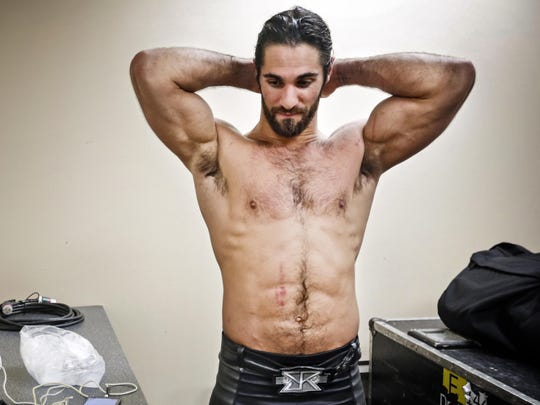 Seth Rollins of WWE cools down backstage after a match in Moline, Ill., on April 28, 2015. Rollins is from Davenport.