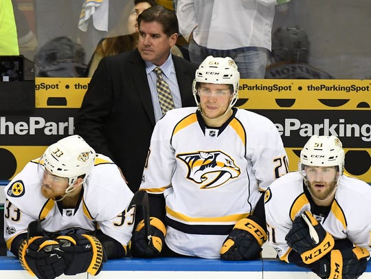 Predators head coach Peter Laviolette, center Colin