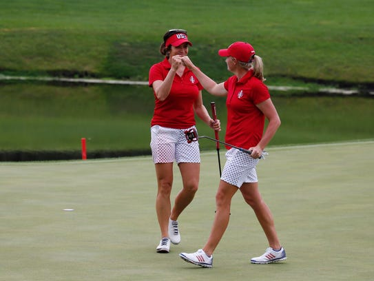 Gerina Piller and Stacy Lewis give each other a fist