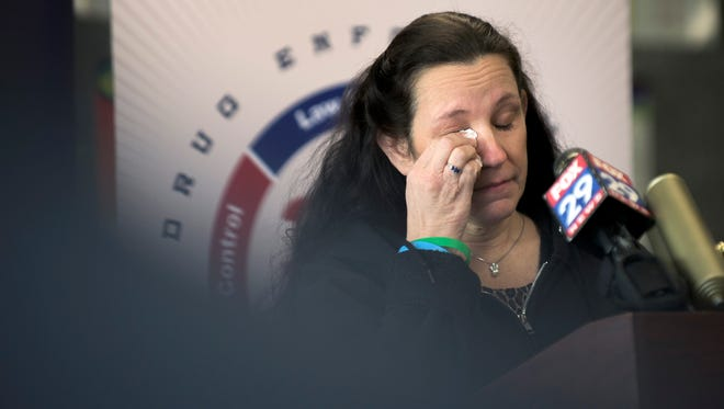 Charlene Maycott wipes a tear while speaking about her daughter during the U.S. Drug Enforcement Administration's press conference to announce the law enforcement agency's new '360 Strategy' in South Jersey. The Hammonton resident said the agency's investment in prevention and education gives her hope that other families won't have to battle opioid addiction.