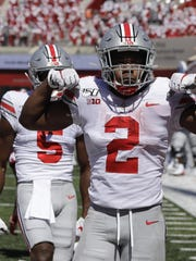 Ohio State running back J.K. Dobbins (2) reacts after a running for a touchdown during the first half against Indiana.