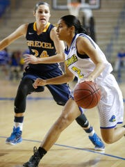 Delaware guard Courtni Green tries to move past Drexel's Rachel Pearson in the first period at the Bob Carpenter Center Friday.