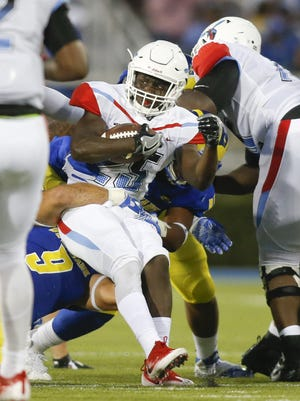 Delaware State running back Mike Waters, seen here against Delaware, rushed for 96 yards in the Hornets' 41-10 loss to Bethune Cookman on Saturday.