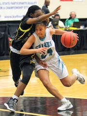 Gulf Coast guard Yasmeen Chang drives against a Winter Haven defender during last year's Class 8A state semifinal game in Lakeland. The Sharks lost, 68-41.