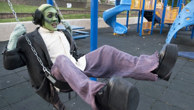 "David McConney of Wilmington, Delaware, who plays the monster in the upcoming production of ""??Young Frankenstein"" at Ritz Theatre Company in Haddon Township, swings in the playground in the Oaklyn-Lions Memorial Park as he cut loose in Oaklyn on Wednesday evening.  ""??Young Frankenstein""?? opens with a preview performance on Thursday and opening night is Friday.  07.09.14"