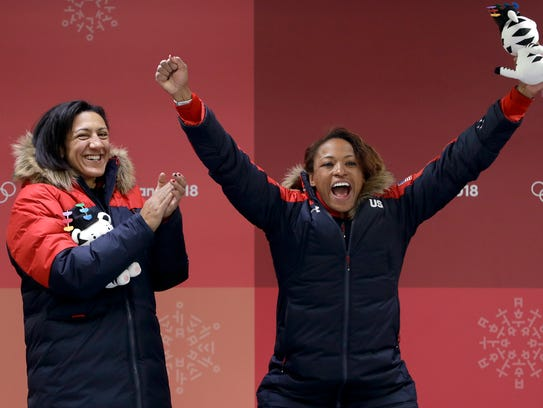 Driver Elana Meyers Taylor, left, and Lauren Gibbs,