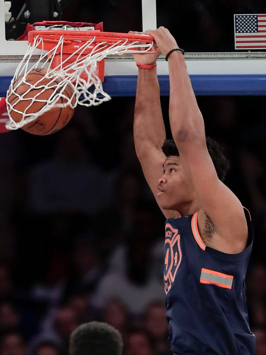 New York Knicks forward Isaiah Hicks (4) dunks against the Charlotte Hornets during the second quarter of an NBA basketball game, Saturday, March 17, 2018, in New York. (AP Photo/Julie Jacobson)